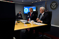 United States President Donald J. Trump attends a teleconference with governors at the Federal Emergency Management Agency headquarters, Thursday, March 19, 2020, in Washington, DC.  US Vice President Mike Pence is at right.<br /> Credit: Evan Vucci / Pool via CNP/AdMedia