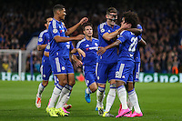 Willian of Chelsea (right) celebrates scoring the opening goal against Maccabi Tel Aviv with team mates during the UEFA Champions League match between Chelsea and Maccabi Tel Aviv at Stamford Bridge, London, England on 16 September 2015. Photo by David Horn.