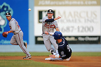 Rome Braves shortstop Matt Lipka #5 makes the turn to complete a double play during a game against the Asheville Tourists at McCormick Field on August 18, 2011 in Asheville, North Carolina. Rome won the game 12-11.   (Tony Farlow/Four Seam Images)