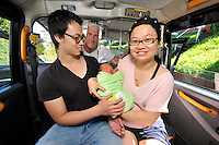 VIDEO AVAILABLE<br /> Pictured: Kai Huang and his partner Qiuxia Chen who gave birth to their son Loeo in the back of a Swansea taxi cab, pictured with cabby Steve Storton. Baby Loeo was born at 6.45 on Sunday evening  in Sketty, Swansea on their way to hospital.<br /> Re: When taxi driver Stephen Storton embarked on his evening shift, he didn't expect one of his customers to give birth in the back of his car.<br /> But that is exactly what happened when the Data Cabs driver picked up Chinese pair Kai Huang and Quix India.<br /> He said he had never seen anything like it after years working as a taxi driver.<br /> &quot;It came up on the computer that there was a taxi booked in Townhill for 6.30pm so off I went.<br /> &quot;When I got there a guy came out and said that his wife was in labor.<br /> &quot;When I was driving to the hospital she screamed that the baby was coming and that she could feel the head.<br /> &quot;I then pulled over by the side of Vivian Road in Sketty and the baby was born at 6.45pm.&quot;<br /> The baby's father Kai Huang described the moment he &quot;freaked out&quot; when his wife Quixia Chen gave birth to their son He said: &quot;I was really scary, I freaked out.<br /> &quot;My wife started experiencing some painful contractions so we phoned the hospital and they told us to get her to the hospital immediately.<br /> &quot;We then phoned a taxi and it arrived within five minutes.<br /> &quot;The baby came really quickly and half way to the hospital the driver had to pull over as the baby was born before the ambulance arrived.<br /> &quot;Both mother and baby are healthy now and the baby is called Loeo.&quot;
