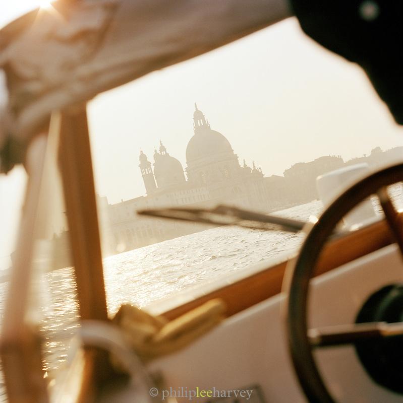 Basilica di Santa Maria della Salute, St Mary of Health, seen from inside a motor boat in Venice, Italy
