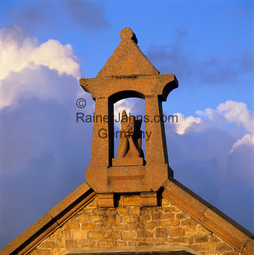 France, Brittany, Ploumanac`h: Carving of Demon on chapel roof