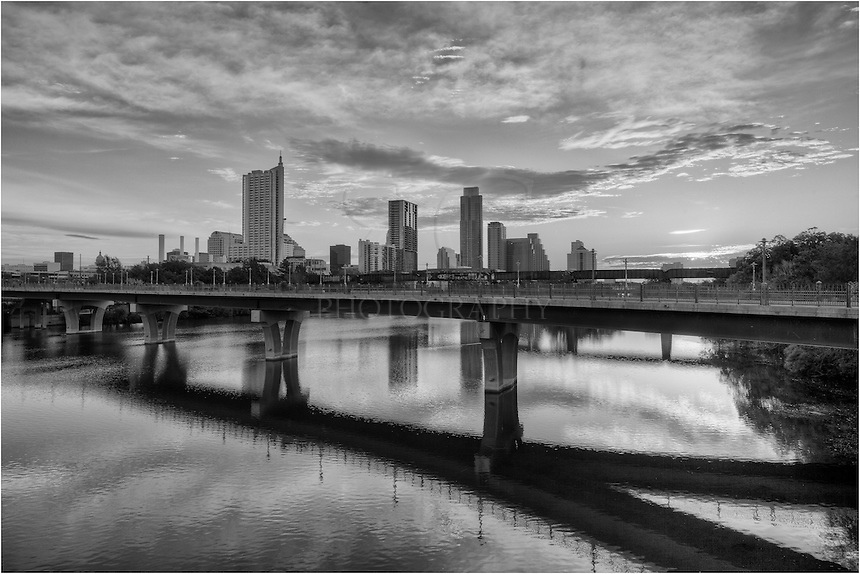 Sunrise in black and white looking at the Austin skyline from Lamar Bridge.