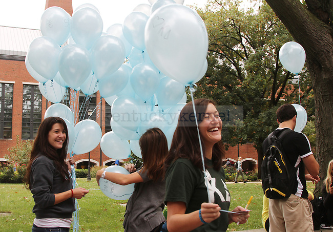 Women from Kappa Delta sorority, including Hope Johnson, center, hand out balloons, pens, stickers and magnets in honor of International Women's Friendship Month to boost women's confidence, outside of White Hall Classroom Building in Lexington, Ky., Sept. 20, 2011. Photo by Becca Clemons | STAFF