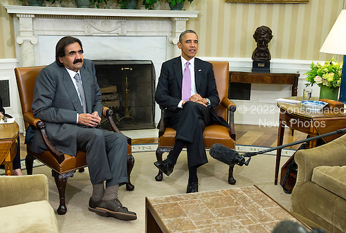 United States President Barack Obama meets with the Amir of Qatar, Hamad bin Khalifa al-Thani, in the Oval Office of the White House on Tuesday, April 23, 2013. <br /> Credit: Joshua Roberts / Pool via CNP