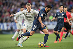 Jose Luis Garcia del Pozo, Recio, (r) of Malaga CF battles for the ball with Toni Kroos of Real Madrid during their La Liga 2016-17 match between Real Madrid and Malaga CF at the Estadio Santiago Bernabéu on 21 January 2017 in Madrid, Spain. Photo by Diego Gonzalez Souto / Power Sport Images