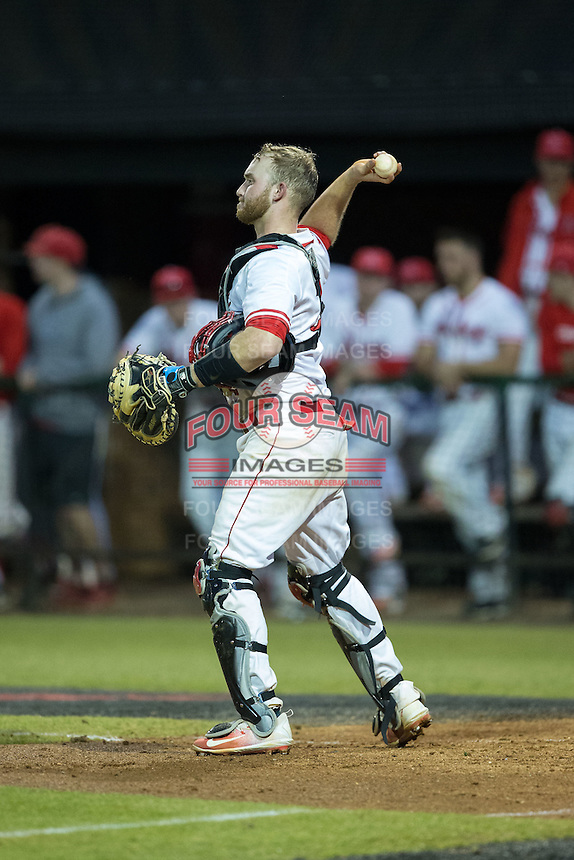 Belmont Abbey Crusaders catcher Thomas Yoder (20) throws the ball back to his pitcher during the game against the Catawba Indians at Abbey Yard on February 7, 2017 in Belmont, North Carolina.  The Crusaders defeated the Indians 12-9.  (Brian Westerholt/Four Seam Images)