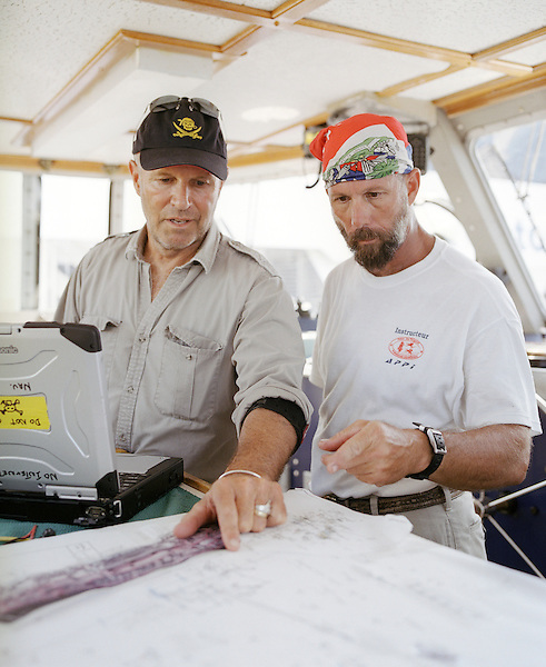 "PROVINCETOWN,MASSACHUSETTS : Barry Clifford, America's top underwater archaeologist and explorer and crew in his pilot room aboard his ship. In 1984, underwater explorer Barry Clifford and his Project Team discovered the site of the 1717 shipwreck of the Whydah off Cape Cod, the only verified pirate shipwreck ever discovered. The Whydah, built as a slave ship in 1715 and captured by pirate Capt. ""Black Sam"" Bellamy two years later. The Whydah sank in a ferocious storm off Cape Cod in 1717, killing Bellamy and all but two of the 146 men on board. Using historical research, remote-sensing techniques and underwater surveys, Clifford has been involved in the survey and/or recovery of numerous other shipwrecks. They include more than 50 wrecks around Cape Cod, various 17th and 18th century wrecks in the Indian Ocean, more than 20 wrecks in New York's East River, and others in Florida, the Bahamas, the Bay of Corinth, Boston, Belize and Panama. Provincetown, Massachusetts. USA."