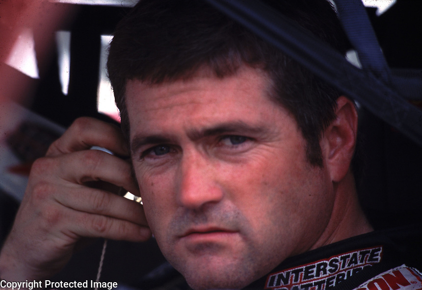NASCAR Winston Cup points leader Bobby Labonte sits in his car at Darlington, SC on Friday 9/1/00 as he waits to qualify for the Pepsi Southern 500 stock car race. (Photo by Brian Cleary)