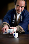 Photo shows Suehiro Sake Brewery in Aizu-wakamatsu City, Fukushima, Japan on 15 March 2013.  Photographer: Robert GilhoolyA staffer pours some sake at the Suehiro Sake Brewery in Aizu-wakamatsu City, Fukushima, Japan on 15 March 2013.  Photographer: Robert Gilhooly