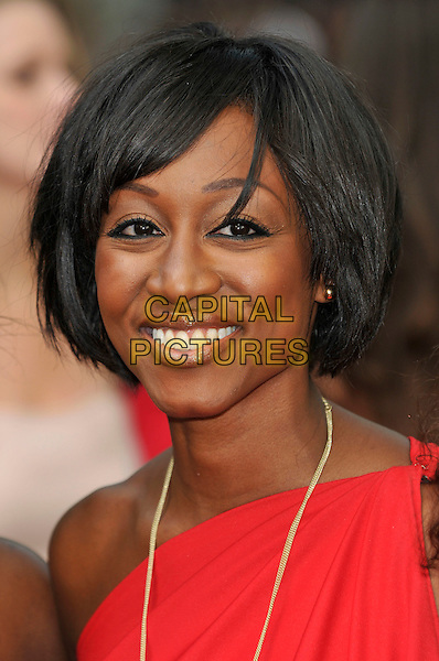 "BEVERLEY KNIGHT.Attending the ""Sex And The City 2"" UK film premiere, Odeon Leicester Square, London, England, UK..May 27th 2010.arrivals headshot portrait smiling gold necklaces red one shoulder.CAP/PL.©Phil Loftus/Capital Pictures."