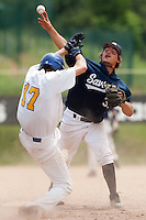 23 May 2009: Romain Martinez-Scott of Savigny throws the ball over Matthieu Brelle Andrade of Senart for the double play during the 2009 challenge de France, a tournament with the best French baseball teams - all eight elite league clubs - to determine a spot in the European Cup next year, at Montpellier, France. Savigny wins 4-1 over Senart.