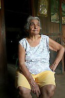America Lobato Conceicao sits on the front porch of her home in Fordlandia, a former factory town created by the Ford Motor Company on the banks of the Tapajós River, September 6, 2005. Conceicao, who worked as nanny for Ford executives, is one of the few residents who remember the Americans. Deep in the Amazon forest, 12 hours by boat from the regional capital of Santarem in Brazil's Pará state, the rubber plantation and processing factory is now abandoned to the rain-forest, an aging memorial to American ideals and to the Brazilian reality. It almost seems like time has stopped in Fordlandia, or better yet, time has passed it by. In typical american style, it was organized and efficient, an idea admired by many Brazilians, and perhaps more so by residents of the untamed Amazon. But It is an idea hard to implement in the wilds of the amazon. Some might also say that it is also a typical American style the way Ford came here and tried to implement something with little knowledge of the local customs or terrain. From 1928 to 1945, Ford came tried to take control of his rubber supply, one of the most important products of the rainforest. After only 17 years the company admitted defeat and retreated from the forest.