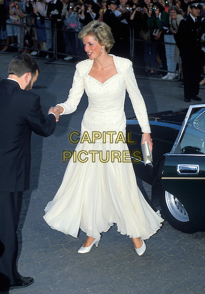 HRH, THE PRINCESS DIANA OF WALES.at Royal Premiere of Back to the Future III,.London, England, 1st January 1990..Lady Di family her royal highness full length cream beaded top dress skirt shoes shaking hands meeting greeting.Ref: CAP/PL.©Phil Loftus/Capital Pictures