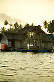 INDONESIA, Mentawai Islands, Kandui Resort, man standing in his floating home