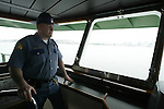 A Washington State Trooper conducting anti-terrorism patrols on Washington State Ferries to and from Seattle's Coleman Dock .  Jim Bryant Photo. ©2010. All Rights Reserved.