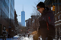 The One World Trade Center is seen at the background while people walk outside  after the pass of the winter storm JONAS, in New York, 01/24/2016. Photo by VIEWpress