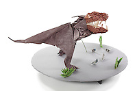 Detail of Origami model.<br /> Yutyrannus huali:  head designed by Robert Lang; body designed by Roman Diaz and Joseph Wu; Tyrannosaurus rex folded by Talo Kawasaki<br /> Pigeons adapted Dove by Dr. V. Solorzano, folded by Talo Kawasaki<br /> Grass designed and folded by Delrosa Marshall