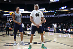 WINSTON-SALEM, NC - FEBRUARY 24: Notre Dame's Bonzie Colson and Elijah Burns (behind). The Wake Forest University Demon Deacons hosted the University of Notre Dame Fighting Irish on February 24, 2018 at Lawrence Joel Veterans Memorial Coliseum in Winston-Salem, NC in a Division I men's college basketball game. Notre Dame won the game 76-71.