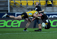 Jordie Barrett tackles Mitch Karpik during the Super Rugby quarterfinal match between the Hurricanes and Chiefs at Westpac Stadium in Wellington, New Zealand on Friday, 20 July 2018. Photo: Dave Lintott / lintottphoto.co.nz