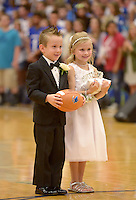 NWA Democrat-Gazette/BEN GOFF @NWABENGOFF<br /> Kaysen Gill and Brooklynn Zechiedrich bear the ball and crown on Friday Sept. 18, 2015 during the homecoming ceremony at Rogers High School.