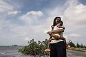 "Indonesia – Sumatra – Banda Aceh - Lam Manyang – Lisma, 29-year-old holding her three-year-old daughter.  ""I still have recurrent nightmares about the tsunami. I see the waves coming back again"". Lisma was able to meet the rest of her family only three days later, in the house of a relative. Her mother and two of her sisters were missing and were never found. ""For the first two years we kept on expecting them back. Then we gave up"" she says. ""The tsunami helped me become a better person"" she concludes. ""Before I was young and dismissive of any advice my parents would give me. Only when I lost my mother I realized the importance of what she taught me""."