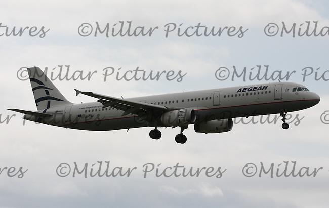 An Aegean Airlines Airbus A321-232 Registration SX-DVZ landing at London Heathrow Airport on 29.5.11.