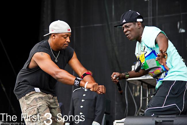 Chuck D. (born Carlton Douglas Ridenhour) and Flavor Flav (born William Jonathan Drayton, Jr.) of Public Enemy perform during the 2013 Budweiser Made in America Festival in Philadelphia, Pennsylvania.