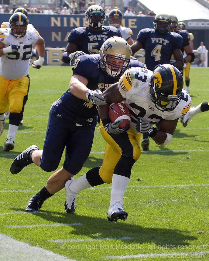 September 20, 2008: Pitt linebacker Scott McKillop tackles Iowa running back Shonn Greene (23). The Pitt Panthers defeated the Iowa Hawkeyes 21-20 on September 20, 2008 at Heinz Field, Pittsburgh, Pennsylvania.
