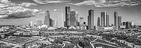 Houston Skyline Aerial BW Pano -<br /> Houston skyline panorama aerial of the city from this birds eye view which includes the Buffalo Bayou along with the Jamail Skate Park and the Eleanor Tinsley Park.  What is nice is this is a view you usually see from a plane so you can see all the citues skyscrapers in this downtown in view. In this skyline pano you can see many of the  areas in downtown with the parks along the Buffalo Bayou.  We use a full frame camera on our aerials so they have the same resolution as our other cameras. We get the highest quality image which can be printed easlity as a 20 x 60 or larger size without loss of resolution for panos.