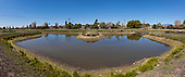 Desilting pond's zig-zag design helps slow down water, allowing for silt to settle out before the water is directed towards the infiltration basins. San Gabriel Spreading Grounds, Water Replenishment District – WRD, Pico Rivera, Los Angeles County