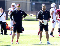 STANFORD, CA - MARCH 7, 2014--Stanford Associate Head Coach and Andrew Luck Director of Offense Mike Bloomgren and Football coach David Shaw, during Open Practices at Stanford University.