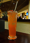Strawberry drink with ice and straw