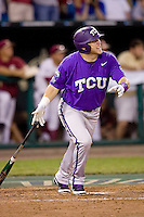 TCU's 1B Matt Curry hits a grand slam in the 8th inning against Florida State at the College World Series on June 23rd, 2010 at Rosenblatt Stadium in Omaha, Nebraska.  (Photo by Andrew Woolley / Four Seam Images)
