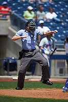 Umpire Matthew Czajak makes a call during a game between the Midland RockHounds and Tulsa Drillers on June 3, 2015 at Oneok Field in Tulsa, Oklahoma.  Midland defeated Tulsa 5-3.  (Mike Janes/Four Seam Images)