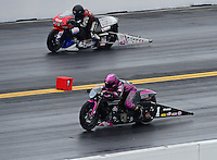 Oct. 8, 2012; Mohnton, PA, USA: NHRA pro stock motorcycle rider Eddie Krawiec (near lane) races alongside Craig Treble during the Auto Plus Nationals at Maple Grove Raceway. Mandatory Credit: Mark J. Rebilas-