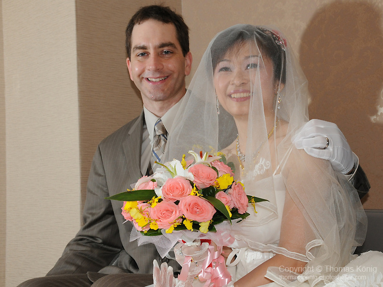 Taiwanese Wedding -- Here they receive guests in the hotel room....