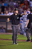 Umpire Brandon Mooney yells at the Dayton players to remain on the bench after Matt Rose (not pictured) was hit by a pitch during a game between the South Bend Cubs and Dayton Dragons on May 11, 2016 at Fifth Third Field in Dayton, Ohio.  South Bend defeated Dayton 2-0.  (Mike Janes/Four Seam Images)