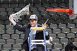 24 MAR 2012:  Head Coach Brad Jackson of Western Washington University celebrates after cutting down the net following the game against the University of Montevallo during the Division II Men's Basketball Championship held at the Bank of Kentucky Center in Highland Heights, KY. Western Washington won the national title 72-65.  Joe Robbins/NCAA Photos