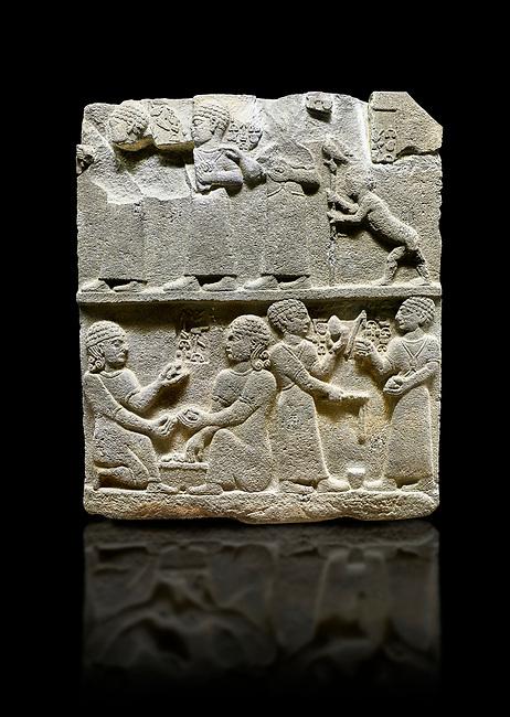 "Hittite monumental relief sculpted orthostat stone panel of Royal Buttress. Basalt, Karkamıs, (Kargamıs), Carchemish (Karkemish), 900 - 700 B.C. Anatolian Civilisations Museum, Ankara, Turkey.<br /> <br /> This panels scene showing 8 out of 10 children of the King, the hieroglyphs reads as follows: ""Malitispas, Astitarhunzas, Tamitispas,Isikaritispas, Sikaras, Halpawaris, Ya hilatispas"". Above, there are three figures holding knucklebones (astragalus) and one figure walking by leaning on a stick; below are two each figures playing the knucklebones and turning whirligigs.  <br /> <br /> Against a black background."