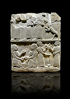 "Hittite monumental relief sculpted orthostat stone panel of Royal Buttress. Basalt, Karkamıs, (Kargamıs), Carchemish (Karkemish), 900 - 700 B.C. Anatolian Civilisations Museum, Ankara, Turkey.<br /> <br /> This panels scene showing 8 out of 10 children of the King, the hieroglyphs reads as follows: ""Malitispas, Astitarhunzas, Tamitispas,Isikaritispas, Sikaras, Halpawaris, Ya hilatispas"". Above, there are three figures holding knucklebones (astragalus) and one figure walking by leaning on a stick; below are two each figures playing the knucklebones and turning whirligigs.  <br /> <br /> Against a black background."