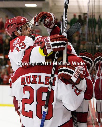 Alex Killorn (Harvard - 19), Chris Huxley (Harvard - 28), Danny Biega (Harvard - 9) - The Harvard University Crimson defeated the visiting Colgate University Raiders 6-2 (2 EN) on Friday, January 28, 2011, at Bright Hockey Center in Cambridge, Massachusetts.