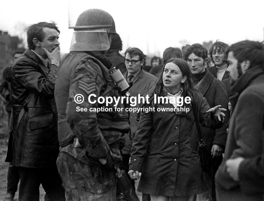 Mid-Ulster MP Bernadette Devlin in discussion with a British Army sergeant at a road-block during a banned anti-internment march between Dungannon and Coalisland roadblock. 23rd January 1972. Also in the photo, left, is SDLP MP in the N Ireland Parliament, Austin Currie, 197201230083e<br />