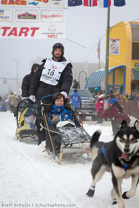 Nicolas Petit and team leave the ceremonial start line at 4th Avenue and D street in downtown Anchorage during the 2013 Iditarod race. Photo by Jim R. Kohl/IditarodPhotos.com