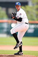 May 28, 2009:  Relief Pitcher Eddie Kunz of the Buffalo Bisons delivers a pitch during a game at Coca-Cola Field in Buffalo, NY.  The Bisons are the International League Triple-A affiliate of the New York Mets.  Photo by:  Mike Janes/Four Seam Images
