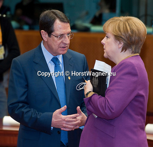 Brussels-Belgium - March 15, 2013 -- European Council, EU-summit meeting of Heads of State / Government; here, Nicos ANASTASIADES (le), President of Cyprus, with Angela MERKEL (ri), Federal Chancellor of Germany -- Photo: © HorstWagner.eu
