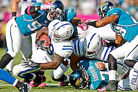 October 03, 2010:  Indianapolis Colts running back Joseph Addai (29) is tackled by a host of Jacksonville Jaguar defenders during 1st half AFC South Conference action between the Jacksonville Jaguars and the Indianapolis Colts at EverBank Field in Jacksonville, Florida.   Jacksonville defeated Indianapolis 31-28........