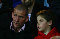 PICTURE BY VAUGHN RIDLEY/SWPIX.COM - Rugby League - Super League - Leeds Rhinos v Huddersfield Giants - Headingley, Leeds, England - 30/03/12 - New England Rugby Union Manager Stuart Lancaster watches the match with his son.