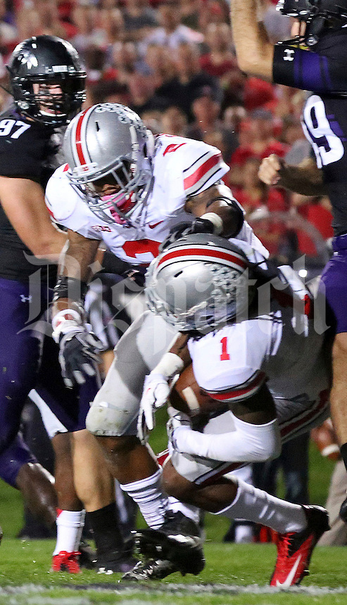 Ohio State Buckeyes cornerback Bradley Roby (1)scores a touchdown in the first  quarter of their game at Ryan Field in Evanston, IL on October 5, 2013. Columbus Dispatch photo by Brooke LaValley)