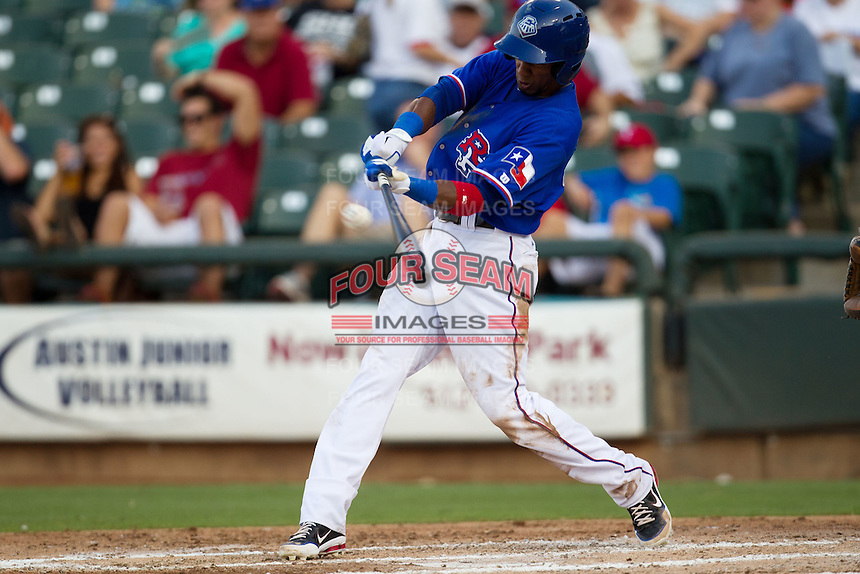 Round Rock Express outfielder Julio Borbon #20 swings during the Pacific Coast League baseball game against the Oklahoma City RedHawks on June 15, 2012 at the Dell Diamond in Round Rock, Texas. The Express shutout the RedHawks 2-1. (Andrew Woolley/Four Seam Images).